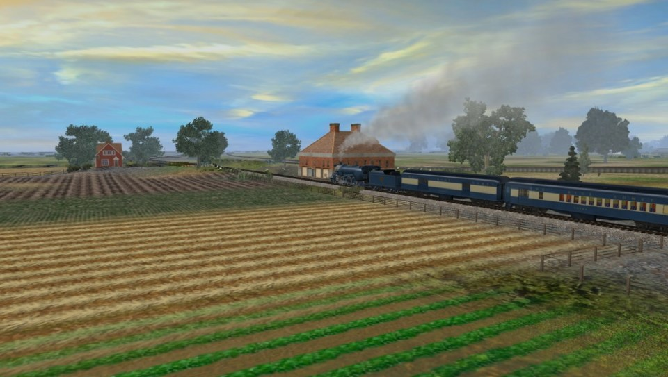 Blue Comet steaming through the farmland